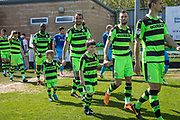 Mascots with the players during the EFL Sky Bet League 2 match between Forest Green Rovers and Grimsby Town FC at the New Lawn, Forest Green, United Kingdom on 5 May 2018. Picture by Shane Healey.