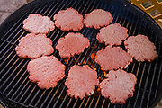 Meat grinder Kelvin Lester grills hamburger patties at his home in Grand Meadow, Minnesota. (Kelvin Lester is featured in the book What I Eat: Around the World in 80 Diets.)