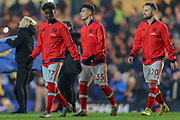 Arsenal midfielder Bukayo Saka (77), Arsenal forward Gabriel Martinelli (35), Arsenal defender Shkodran Mustafi (20), walk on the pitch before the Premier League match between Chelsea and Arsenal at Stamford Bridge, London, England on 21 January 2020.