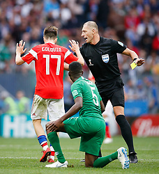 June 14, 2018 - Moscou, Rússia - MOSCOU, MO - 14.06.2018: RUSSIA VS SAUDI ARABIA - Argentine referee Néstor Pitana applies yellow card to Aleksandr Golovin of Russia after he commits foul in Omar Othamn of Saudi Arabia during the match between Russia and Saudi Arabia valid for the first round of group A of the 2018 World Cup held at Lujniki Stadium in Moscow, Russia. (Credit Image: © Marcelo Machado De Melo/Fotoarena via ZUMA Press)