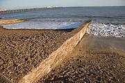 Concrete groynes showing different beach levels, Felixstowe beach, Suffolk, England