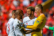 England goalkeeper Jordan Pickford celebrates at full time with England defender Fabian Delph and England defender Kyle Walker during the UEFA Nations League 3rd place play-off match between Switzerland and England at Estadio D. Afonso Henriques, Guimaraes, Portugal on 9 June 2019.