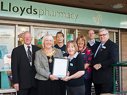 Lloyds Pharmacy Stocksbridge has achieved the status of 'Healthy Living Pharmacy'. A special accreditation for offering high levels of health screening  and advice to the local community. Pharmacy Manager Jackie Walter receiving the award from Mayor of Stocksbridge Susie Abrahams, also pictured left to right are NHS Sheffield Commissioning Manager Gareth Johnstone, Lloyds Stcksbridge Healthy Living Champion Vikki Sheppard, Valley Medical Centre Practace Manager Liz Sedgwick Dr Peter Moulsher GP and Lloyds Area Manager Greg Campbell....<br />