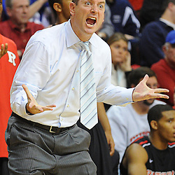Rutgers Scarlet Knights head coach Mike Rice reacts to a foul called on his team during Rutgers' 67-60 upset victory over #8 UConn in NCAA Big East Basketball action at the Louis Brown Athletic Center in Piscataway, N.J. on Jan 7, 2012.