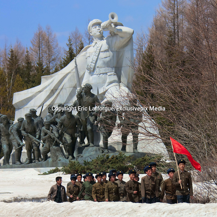 """PAEKTU, LAND OF NORTH KOREAN LEGENDS<br /> <br /> Mount Paektu volcano is considered a holy place for North Koreans. It is deemed the place of origin for them. The country's founding father Kim Il- Sung commanded anti-Japanese guerrilla in the 50's from a secret camp in this place.<br /> North Korea says his son Kim Jong-il was born there in 1942. He was actually born in Siberia, where his father had taken refuge from Japanese troops.<br /> The dear Leaders are said to have a """"mount Paektu bloodline ». A famous slogan says: « Let us all turn out in the general offensive to hasten final victory in the revolutionary spirit of Paektu! »<br /> A new probelm may erupt: when North Korea tests a nuclear weapon, specialists say the energy could trigger a volcanic...eruption in Paektu. That could be a huge disaster, killing thousands in North Korea and on the chinese side too.<br /> <br /> Photo shows: The first stop of the pilgrimage is in Samjiyon Grand Monument. The famous statue of the bugler is a national icon in the DPRK that can be seen in many places.<br /> ©Eric Lafforgue/Exclusivepix Media"""