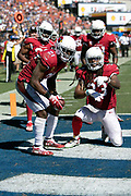Arizona Cardinals defensive back Patrick Peterson (21) celebrates with Arizona Cardinals defensive back Tre Boston (33) and Cardinals teammates after intercepting a third quarter pass at the Cardinals 2 yard line during the 2018 NFL regular season week 2 football game against the Los Angeles Rams on Sunday, Sept. 16, 2018 in Los Angeles. The Rams won the game in a 34-0 shutout. (©Paul Anthony Spinelli)