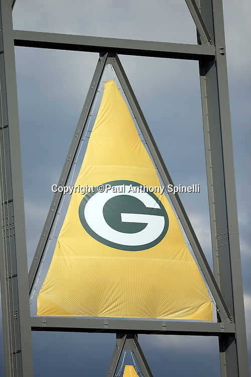 The Green Bay Packers logo is pictured on a large banner over the field before the 2016 NFL Pro Football Hall of Fame preseason football game against the Indianapolis Colts on Sunday, Aug. 7, 2016 in Canton, Ohio. The game was canceled for player safety reasons due to the condition of the paint on the turf field. (©Paul Anthony Spinelli)