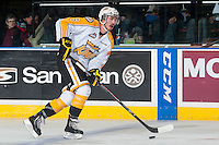KELOWNA, CANADA - OCTOBER 25: Ryan Pilon #6 of Brandon Wheat Kings skates with the puck against the Kelowna Rockets on October 25, 2014 at Prospera Place in Kelowna, British Columbia, Canada.  (Photo by Marissa Baecker/Shoot the Breeze)  *** Local Caption *** Ryan Pilon;