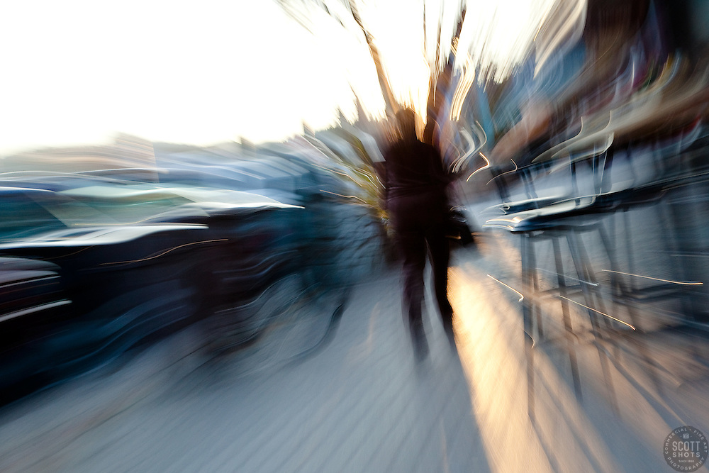 """Lady in Downtown Truckee"" - This abstract photo of a lady walking in Downtown Truckee, CA was achived by zooming the lens during the exposure."