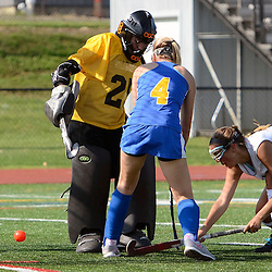 Strath Haven's Lucy Mester (10) sneaks one past Springfield's Kylie Pfizenmayer (4) and goalie Ally Scanlon (25) during the Springfield at Strath Haven girls field hockey game in Nether Providence on Thursday, September 4, 2014.  (Times staff / TOM KELLY IV)