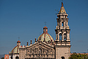 The tiled bell tower and domes on the Baroque Churrigueresque style Iglesia del Carmen church and convent in the historic center on the Plaza del Carmen in the state capital of San Luis Potosi, Mexico.