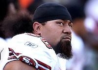 Oct 21, 2007: East Rutherford, NJ, USA: San Francisco 49ers defensive tackle (90) Isaac Sopoaga looks at the scoreboard while sitting on the bench during the first half while playing the New York Giants at Giants Stadium.  The Giants won 33-15..