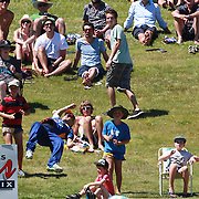 Nathan McCullum of the Otago Voltzs fails to hold a catch as he falls over the boundary rope.  Batsman Brendon Taylor who was awarded six runs as spectators watch during the Otago Voltz V Wellington Firebirds HRV Cup match at the Queenstown Events Centre, Queenstown, New Zealand. 31st December 2011