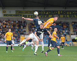 Oxford United's Michael Raynes Southend United's Barry Corr and Southend United's Cauley Woodrow all go for the ball - Photo mandatory by-line: Nigel Pitts-Drake/JMP - Tel: Mobile: 07966 386802 05/10/2013 - SPORT - FOOTBALL - Kassam Stadium - Oxford - Oxford United v Southend United - Sky Bet League 2
