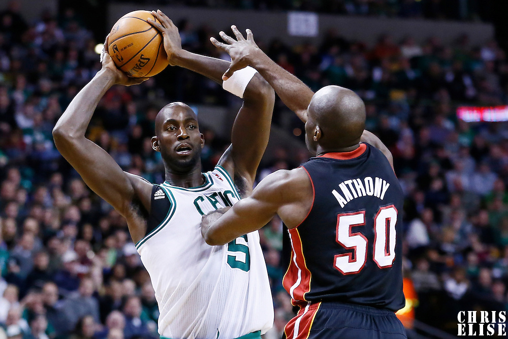 27 January 2013: Boston Celtics power forward Kevin Garnett (5) looks to pass the ball over Miami Heat center Joel Anthony (50) during the Boston Celtics 100-98  2OT victory over the Miami Heat at the TD Garden, Boston, Massachusetts, USA.