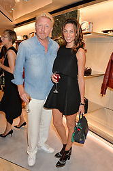 BORIS BECKER and his wife LILY at a dinner hosted by Tod's to celebrate the refurbishment of their store 2-5 Old Bond Street, London on 15th September 2016.