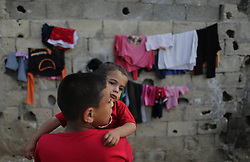 59613445  .Palestinian refugee children play in the northern Gaza Strip town of Beit Lahiya on May 7, 2013. An increasing number of Gazan families were reportedly falling further into poverty, with unemployment rate at over 30% according to 2012 estimates, May 7, 2013. Photo by:  imago / i-Images.UK ONLY