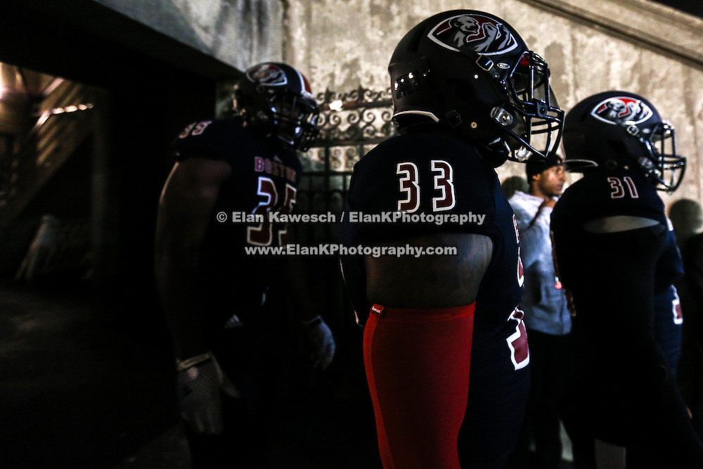 Ashton Cobb #33 of the Boston Brawlers and other members of the Boston Brawlers get ready to take the field prior to the first ever Boston Brawlers home game at Harvard Stadium on October 24, 2014 in Boston, Massachusetts. (Photo by Elan Kawesch)