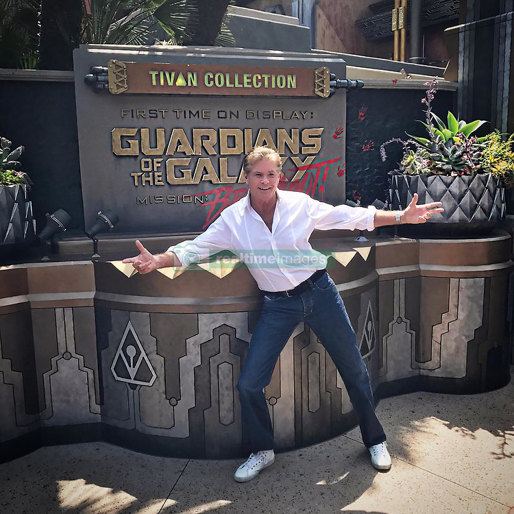 "David Hasselhoff releases a photo on Instagram with the following caption: ""Celebrated the in-home release of #GotGVol2 by riding Mission:BREAKOUT at @disneyland @marvelstudios"". Photo Credit: Instagram *** No USA Distribution *** For Editorial Use Only *** Not to be Published in Books or Photo Books ***  Please note: Fees charged by the agency are for the agency's services only, and do not, nor are they intended to, convey to the user any ownership of Copyright or License in the material. The agency does not claim any ownership including but not limited to Copyright or License in the attached material. By publishing this material you expressly agree to indemnify and to hold the agency and its directors, shareholders and employees harmless from any loss, claims, damages, demands, expenses (including legal fees), or any causes of action or allegation against the agency arising out of or connected in any way with publication of the material."