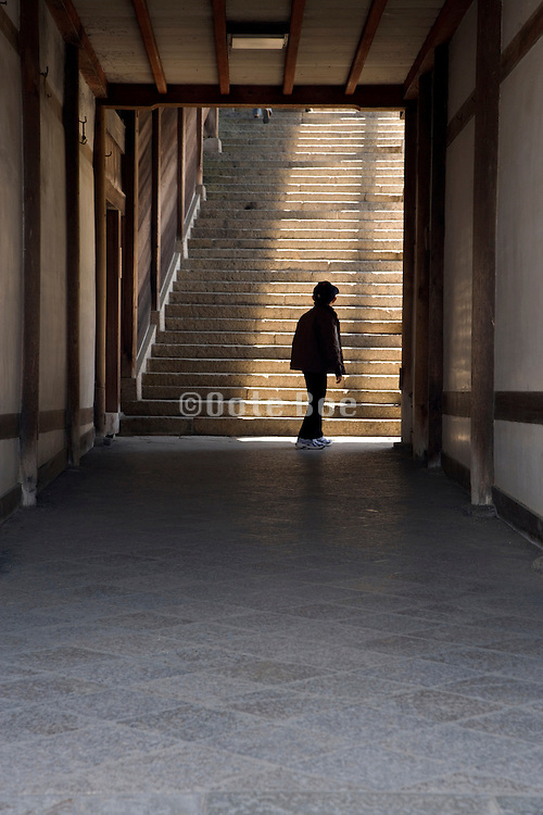 person in front of large stairway at the end of a corridor at the Todai-ji Nigatsu-do temple in Nara Japan