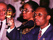 06 FEB 96 - PORT AU PRINCE, HAITI: Outgoing Haitian President Jean Bertrand Aristide leads a toast at the Haitian President's residence in central Port-au-Prince the day before he handed power over to newly elected president Rene Preval, Tuesday, Feb 6, 1996. For the first time in Haiti's history, one democratically elected president succeeded another Wednesday, Feb. 7, 1996, when the tumultous term of President Jean Bertrand Aristide came to an end. .PHOTO BY JACK KURTZ