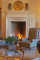 Armchair by a fireplace in luxury home
