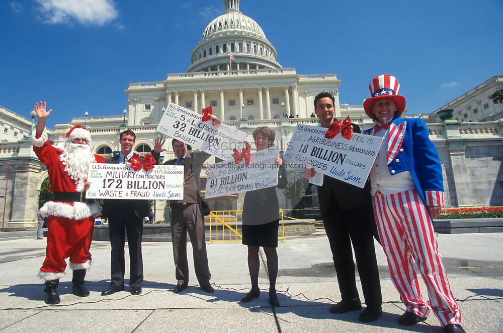 WASHINGTON, DC, USA - 1997/04/15: A small group of protesters dressed in Santa Claus and Uncle Sam costumes protest government waste of tax payer money during a rally on Tax Day at the steps of the U.S. Capitol April 15, 1997 in Washington, DC.    (Photo by Richard Ellis)