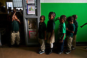 Nathan McNeill, 4, left, signals for his classmates to be quiet before they exit the library that was renovated through the Target School Library Makeover Grant at Adelaide Davis Elementary School on Nov. 26, 2012 in Washington, D.C. Last week DCPS Chancellor Kaya Henderson proposed closing 20 under-enrolled schools in the District. Davis Elementary is one of 20 schools in the DCPS system included in the school closure proposal. There are currently 178 students enrolled in Davis Elementary and the second floor of the school is only used for music classes and the library...CREDIT: Lexey Swall for The Wall Street Journal.DCSCHOOLS