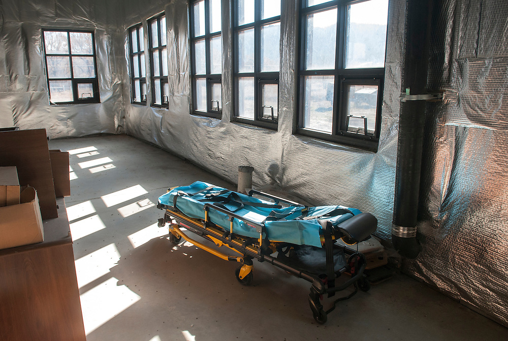A gurney sits in a corner of the unfinished Mora County Courthouse in Mora Wednesday, Nov. 12, 2014. Mora County started construction on the courthouse in 2009 but have not had enough money to complete the project. (Eddie Moore/Albuquerque Journal)