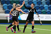 Kayla Whitelock of New Zealand celebrates a goal with teammate Gemma Flynn during the bronze medal match between New Zealand and South Africa. Glasgow 2014 Commonwealth Games. Hockey, Bronze Medal Match, Black Sticks Women v South Africa, Glasgow Green Hockey Centre, Glasgow, Scotland. Saturday 2 August 2014. Photo: Anthony Au-Yeung / photosport.co.nz