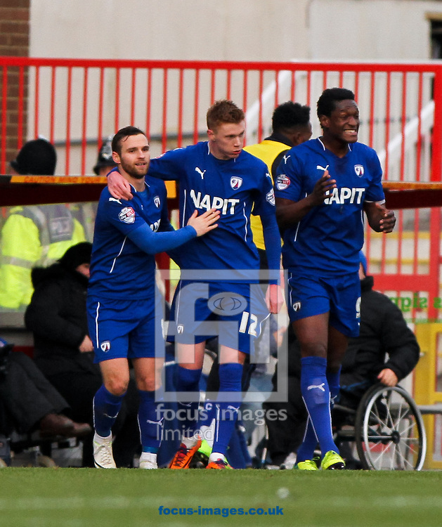 Sam Clucas (centre) of Chesterfield celebrates scoring his sides first goal with his team mates during the Sky Bet League 1 match at the County Ground, Swindon<br /> Picture by Tom Smith/Focus Images Ltd 07545141164<br /> 17/01/2015