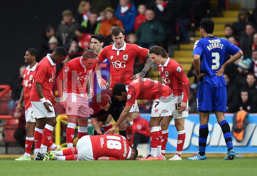 Bristol City captain Aaron Wilbraham writhes in pain - Photo mandatory by-line: Paul Knight/JMP - Mobile: 07966 386802 - 28/02/2015 - SPORT - Football - Bristol - Ashton Gate Stadium - Bristol City v Rochdale - Sky Bet League One