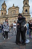 Bogota, Cundinamarca, Colombia - 02.10.2016        <br /> <br /> The Colombian capital Bogota after the failed peace contract referendum. Supporters of the peace treaty partly crying and embracing each other on the Plaza de Bolivar. In addition, heavy word conflicts with opponents of the peace treaty take place. The Colombian citizens voted tightly against the peace treaty negotiated between the government and the left FARC guerrilla. The FARC has been in war with the Colombian government for 52 years.<br />  <br /> Die kolumbianische Hauptstadt Bogota nach dem gescheiterten Friedensreferendum. Anhaenger des Friedensvertrags liegen sich teils weinend auf dem Plaza de Bolivar in den Armen. Mit Gegnern des Friedensvertrages kommt es zu heftigen Wortgefechten. Eine knappe Mehrheit der abstimmenden kolumbianischen Bev&ouml;lkerung votierte gegen den ausgehandelte Friedensvertrag zwischen der Regierung und der linken FARC Guerilla. Die FARC befindet sich seit 52-Jahren im Krieg mit der kolumbianschen Regierung. <br /> <br /> Photo: Bjoern Kietzmann