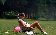 Neshaminy State Park, Bensalem, PA.-.Nicole Pugliese, 18, of Northeast Philadelphia, PA. sits on a sand chair at Neshaminy State Park catching some sun on Thursday afternoon. 3of3