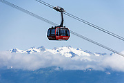 Admire the glacier-clad Coast Mountains from Whistler Village Gondola, in British Columbia, Canada. The Resort Municipality of Whistler is popular for a variety of outdoor sports.