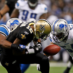 January 7, 2012; New Orleans, LA, USA; New Orleans Saints wide receiver Marques Colston (12) fumbles against the Detroit Lions during the 2011 NFC wild card playoff game at the Mercedes-Benz Superdome. Mandatory Credit: Derick E. Hingle-US PRESSWIRE
