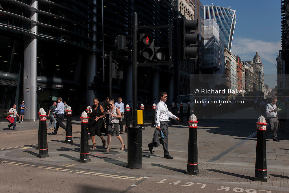 Summer heatwave on Cannon Street in the City of London, UK.
