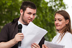 London, UK. 30 May, 2019. Alfie Scanlon, a young man in post-16 education whose mother is a member of SEND national crisis, seen here with Poppy Rose, addresses fellow campaigners attending a demonstration in Parliament Square to demand improvements in the diagnosis and assessment of young people with SEND, assistance for their families, funding and legal and financial accountability for local authorities in their treatment of young people with SEND and their families.