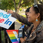 NORTH MIANI, FLORIDA, NOVEMBER 8, 2016<br /> Move On volunteers Lorna Shuford and her mother Delma Rodriguez  hand out signs as they go knocking on doors of homes of voters in the North Miami area as they canvass for democratic votes.<br /> (Photo by Angel Valentin/Freelance)