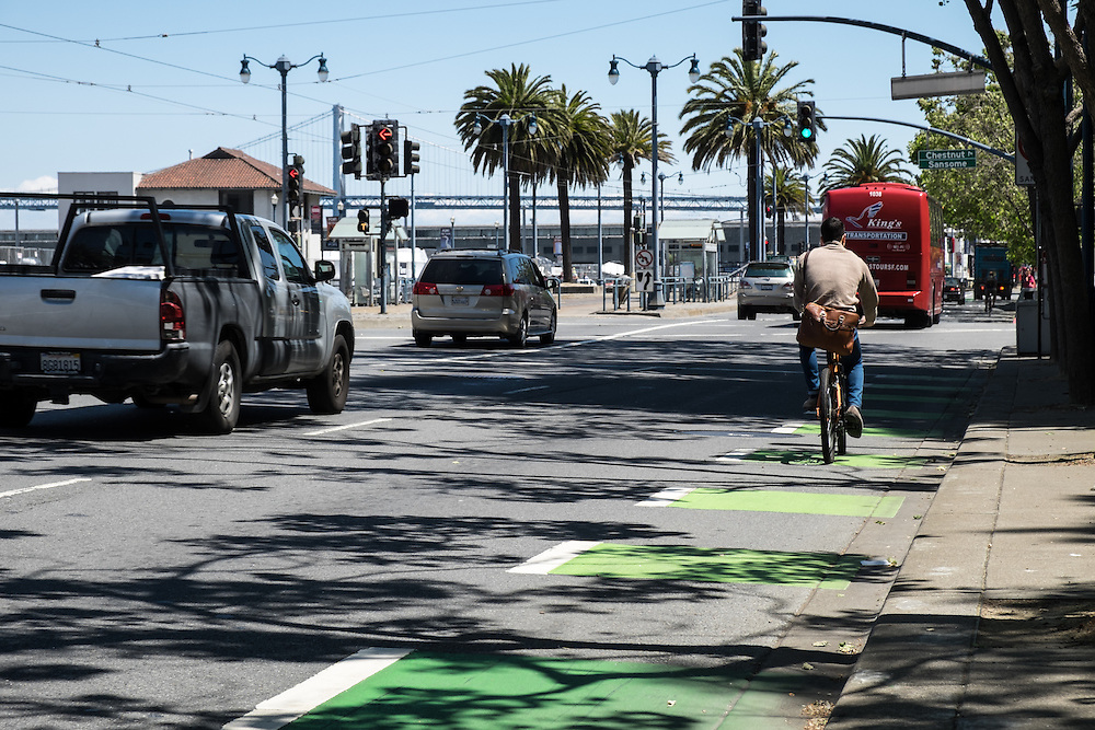 Cyclists in one way cycle track on the west side of the Embarcadero | May 6, 2014