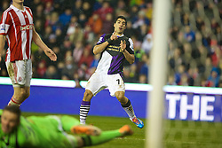 STOKE-ON-TRENT, ENGLAND - Sunday, January 12, 2014: Liverpool's Luis Suarez scores the fourth goal against Stoke City during the Premiership match at the Britannia Stadium. (Pic by David Rawcliffe/Propaganda)