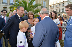 HRH The PRINCE OF WALES meets BEN GOLDSMITH his children and LADY ANNABEL GOLDSMITH at the Quintessentially Foundation and Elephant Family 's 'Travels to My Elephant' Royal Rickshaw Auction presented by Selfridges and hosted by HRH The Prince of Wales and The Duchess of Cornwall held at Lancaster House, Cleveland Row, St.James's, London on 30th June 2015.