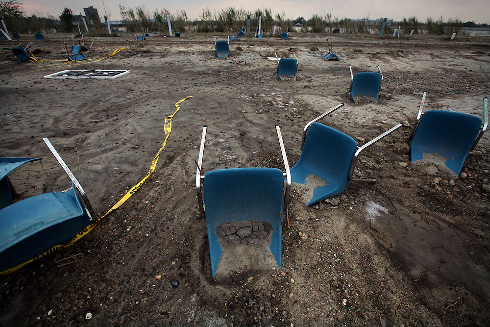 Plastic chairs sit at odd angles in the drying mud after Hurricane Ike caused major flood damage at Pleasure Island Marina in Port Arthur, Texas, Thursday September 18, 2008.