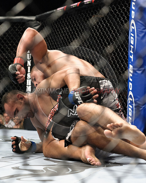 "LAS VEGAS, NEVADA, MAY 24, 2008: Thiago Silva (top) loads up a punch on Antonio Mendes during ""UFC 84: Ill Will"" inside the MGM Grand Garden Arena in Las Vegas"