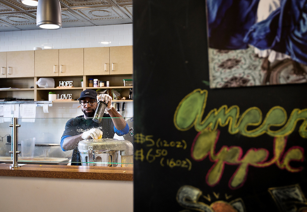 MILWAUKEE, WI - NOVEMBER 17: Maanaan Sabir, owner of The Juice Kitchen, prepares a juice beverage for a customer on Thursday, November 17, 2016.