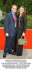 LORD & LADY DALMENY at a party in London on 9th June 2004.PUZ 40