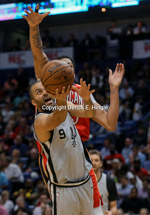 Apr 11, 2018; New Orleans, LA, USA; San Antonio Spurs guard Tony Parker (9) shoots over New Orleans Pelicans forward Anthony Davis (23) during the second half at the Smoothie King Center. The Pelicans defeated the Spurs 122-98. Mandatory Credit: Derick E. Hingle-USA TODAY Sports
