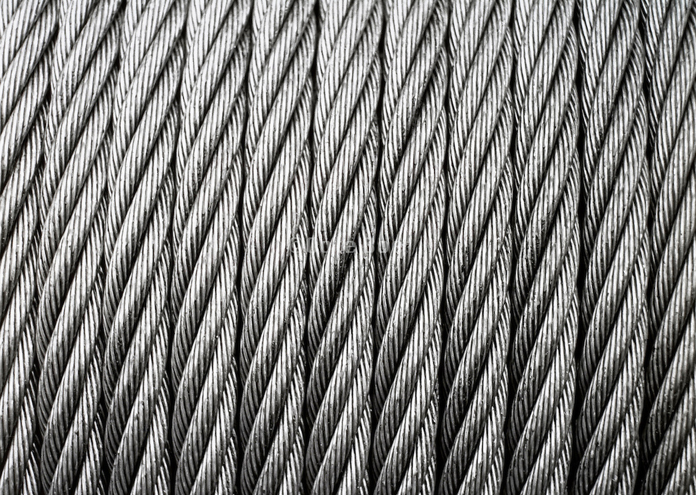 A tight row of heavy metal cables