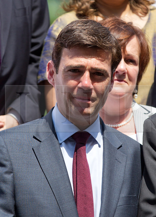 © Licensed to London News Pictures. 17/07/2013. London, UK. Shadow Secretary of State for Health Andy Burnham is joined by Labour Party MP's, at a photo call at the Houses of Parliament in London as a reaction to the governments decision to delay legislation that would have seen cigarettes and tobacco products sold in plain packaging. Photo credit: Matt Cetti-Roberts/LNP