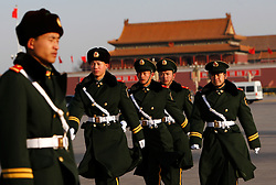 Peoples Liberation Army soldiers patrol at Tiananmen square before the 11th National People's Congress (NPC) held at the Great Hall of People in Beijing, China 05 March 2010. The NPC, China's leading legislative body and all the motions proposed were passed with overwhelming support though no votes were higher than in recent years with some motions having more than 500 opposing versus more than 2,000 in favour.